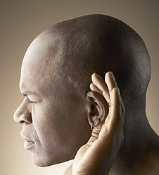 Man listening with his hand to his ear